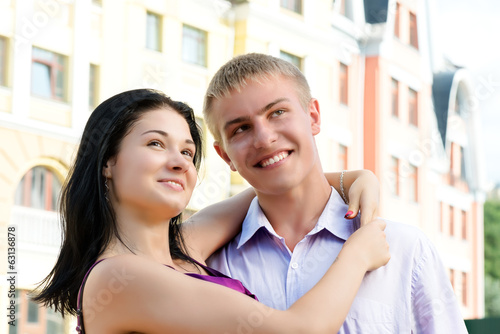 Young smiling couple hugging