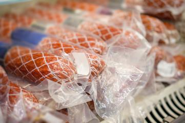 Sausage delicatessen in vacuum pack in shelf in supermarket