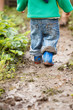 Boy palaying in mud