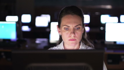 Serious businesswoman using computer in office