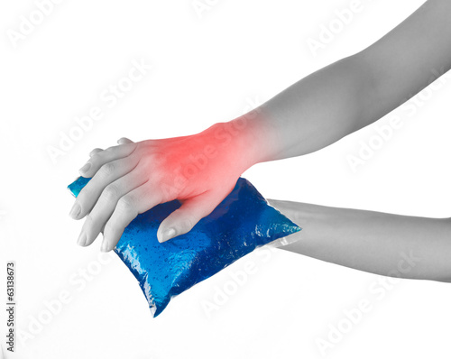 Ice gel pack on a swollen hurting wrist.