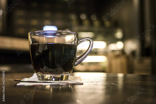 Black coffee on wood table in cafe