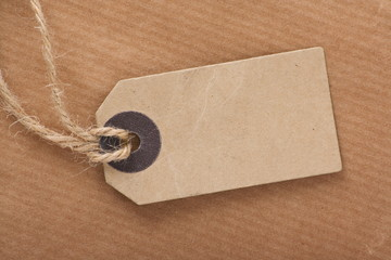 Brown Luggage Tag on Brown Wrapping Paper