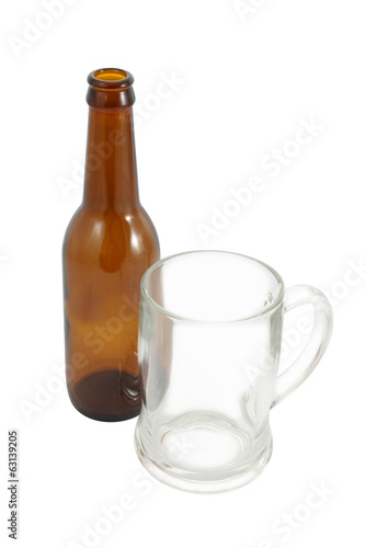 Top side of bottle and glass on white background.