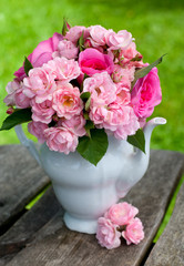 bouquet of roses on wooden surface