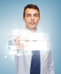 buisnessman pointing finger to virtual screen