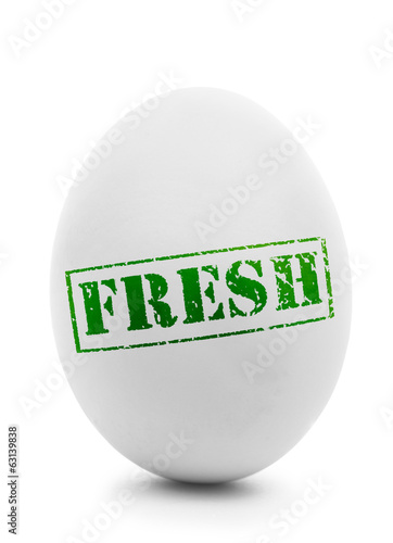 White egg with grunge label Fresh isolated