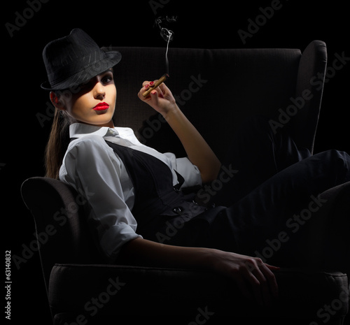 Young woman with cigar sit on chair