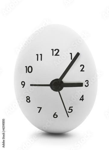 Leinwandbild Motiv Clock dial on white egg isolated on white background