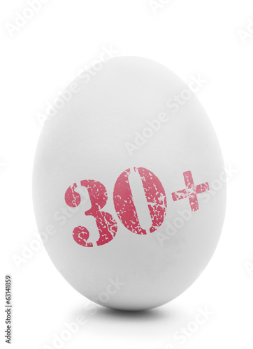 White egg with pink stamp 30+ isolated on white
