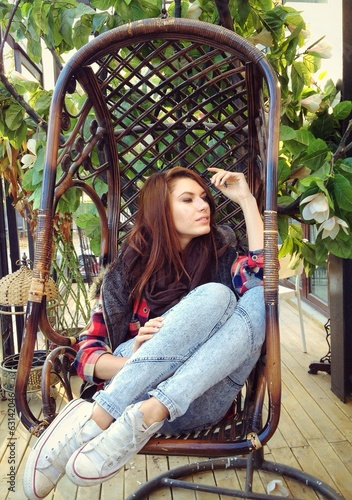 young girl relaxing on lounger