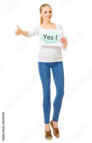 "Young girl with ""Yes"" banner"