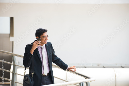 indian business male in a conversation with a phone