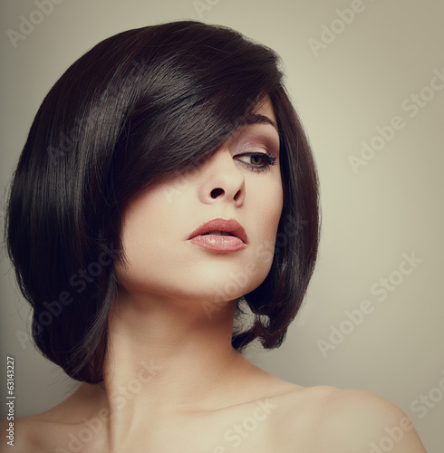 Vintage portrait of beautiful woman. Hair style. Makeup