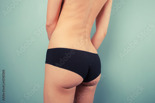 Woman in black underwear touching herself