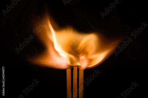 Three Igniting Matches