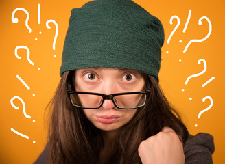 the girl with glasses and hat on a yellow background