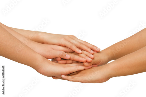 Hands on top of each other showing  unity with their hands toget