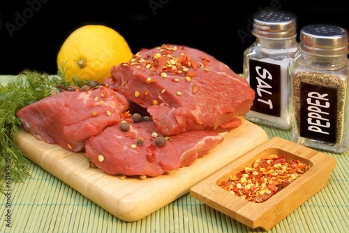 Raw Beef Steaks and Spice isolated on black