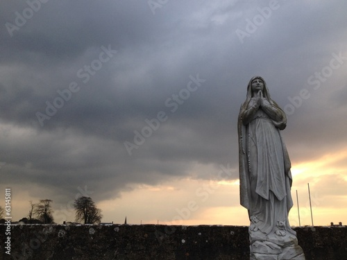 cloudy sunset statue
