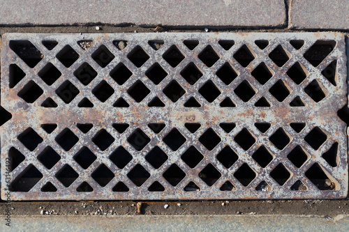 grate in the sidewalk