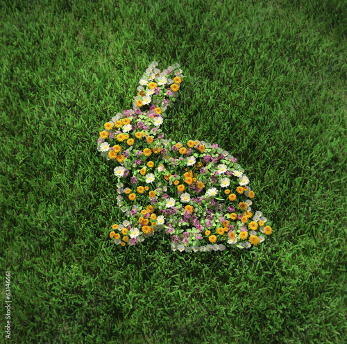 The floral easter rabbit on the grass