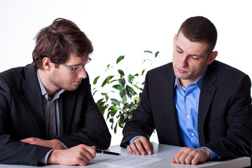 Businesmen consulting an angreements