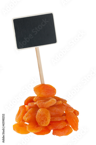Heap of apricot with a pointer for your text