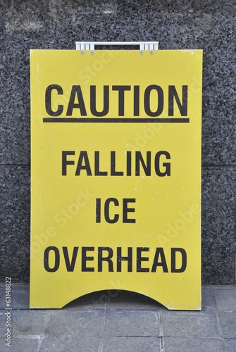 Caution falling ice overhead sign