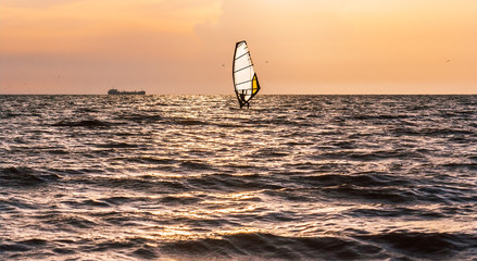 Windsurfing in the sea before the storm
