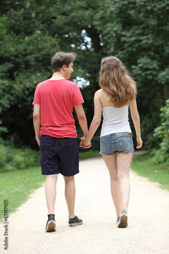 Young dating teenage couple taking a walk