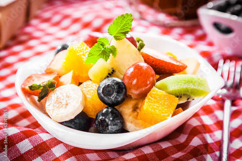 Colorful bowl of tropical fruit salad