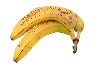 Three overripe bananas with brown spots