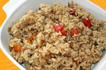 Cooked brown rice with red and yellow peppers