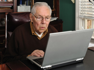 Senior male working on a laptop