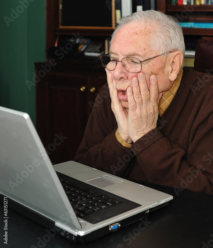 Senior man working on a laptop