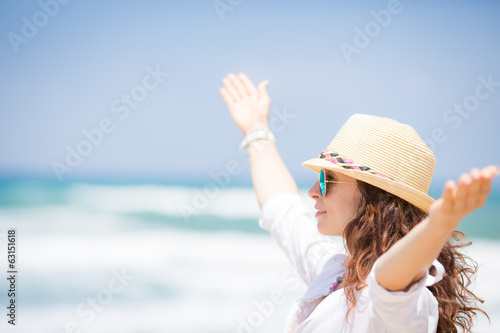 Happy woman enjoying at the beach