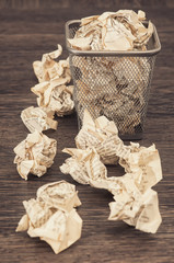 Wastepaper basket with wrinkled paper