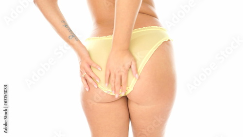 Closeup of sexy woman's behind in yellow panties