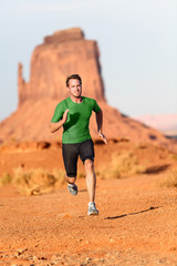Trail running man - male runner in Monument Valley