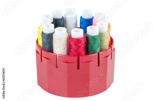 Colored threads in a box on white background