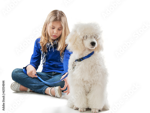 Girl and a white dog sitting