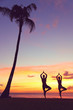 Serene yoga people training in sunset in tree pose