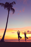 Serene yoga people training in sunset in tree pose poster