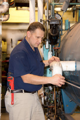Plumber fixing boiler