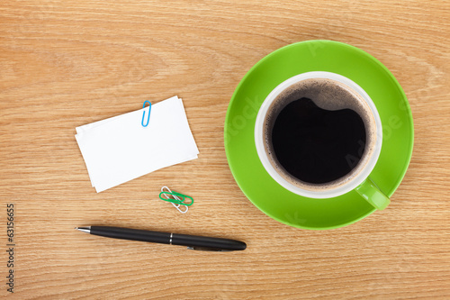 Blank business cards over office table with supplies