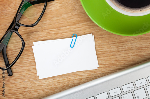 Blank business cards over office table