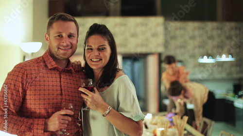 Portrait of couple smiling at party women background.
