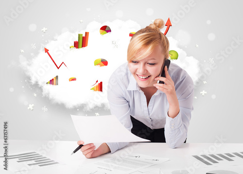 Young businesswoman with cloud in the background containing colo
