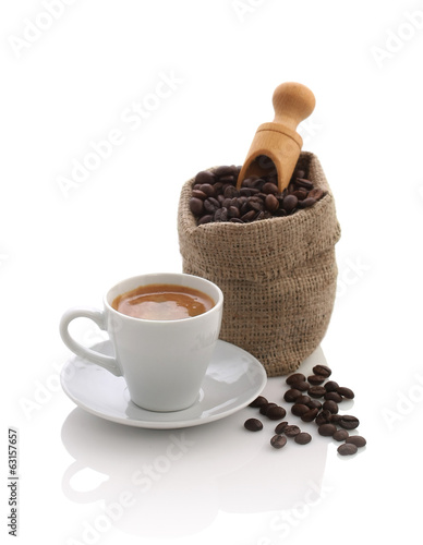 Espresso and a bag of coffee beans with a scoop